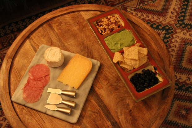 salami cheese gouda guacamole olives nuts dinner setup
