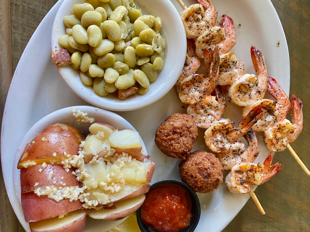 Lunch plate ordered at Zachry's Riverhouse restaurant including: grilled shrimp, buttered potatoes and lima beans with bacon